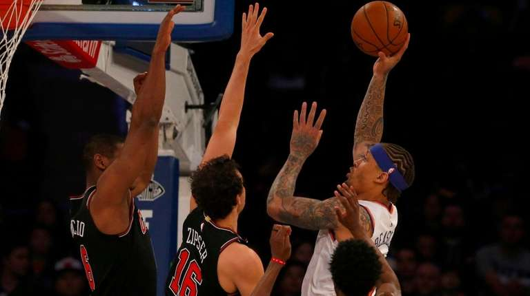 Michael Beasley of the York Knicks puts up