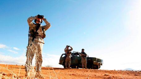 A National Guard unit patrols the Arizona-Mexico border