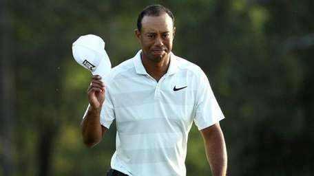 Tiger Woods acknowledges the crowd as he walks