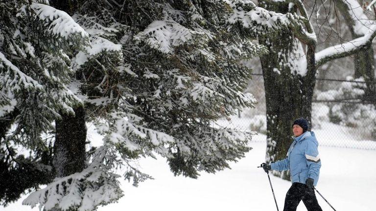 A snowshoer makes a trail across the snow