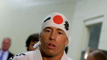 UFC welterweight champion Georges St-Pierre prepares for his