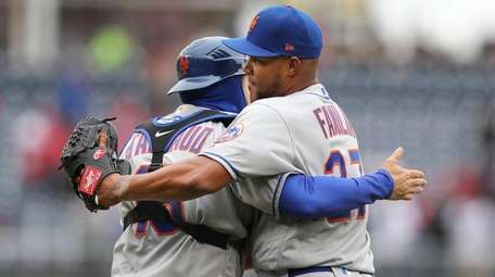 Mets relief pitcher Jeurys Familia and catcher Travis