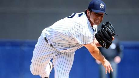 New York Yankees' Sergio Mitre warms up before