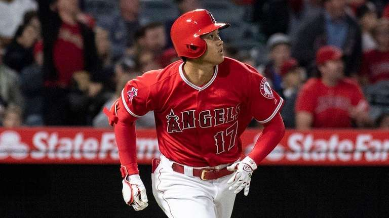 Angels designated hitter Shohei Ohtani watches his solo