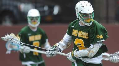 Matt Grillo of Ward Melville maneuvers for a