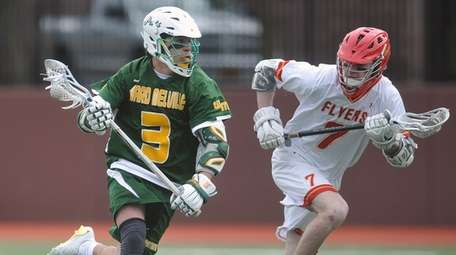 Ryan Pallonetti of Ward Melville, left, gets pressured