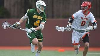 Zach Hobbes of Ward Melville, left, races downfield