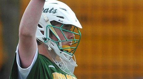 Collin Krieg , Ward Melville goalie, reacts after