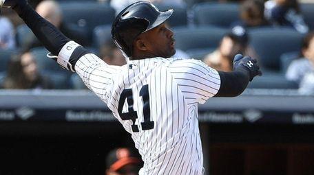 Yankees third baseman Miguel Andujar hits a sacrifice