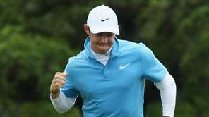 Rory McIlroy reacts to a putt on the