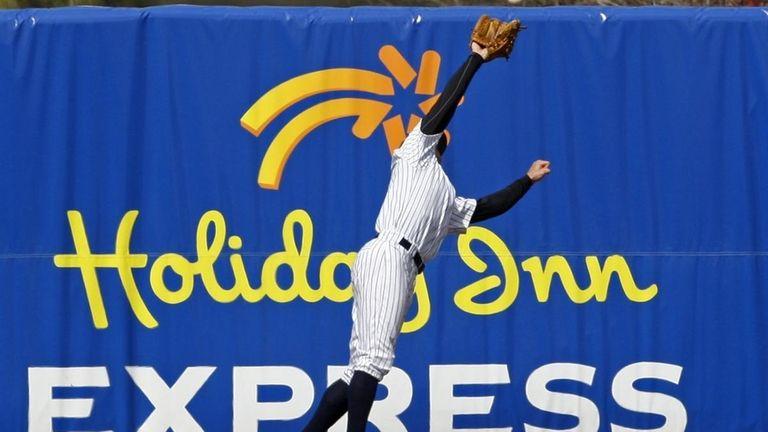 New York Yankees left fielder Brett Gardner leaps