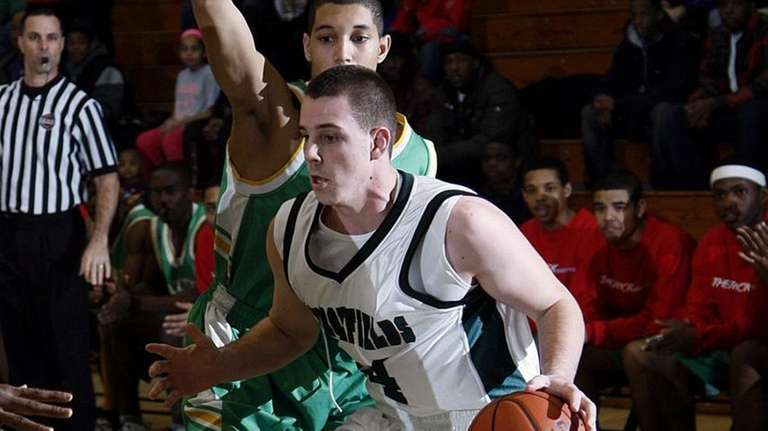 Harborfields' Matt Curry (24) (20 points) drives the
