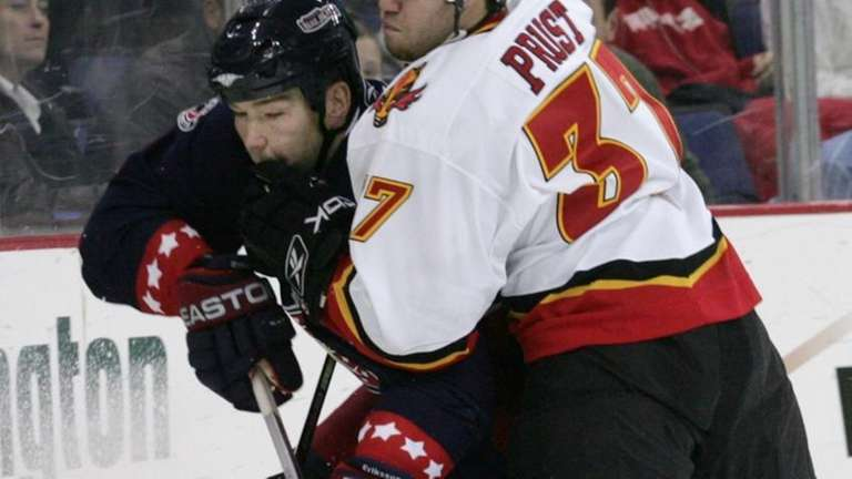 Columbus Blue Jackets' Anders Eriksson, left, and Calgary