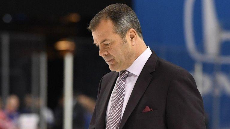 Rangers head coach Alain Vigneault walks off the