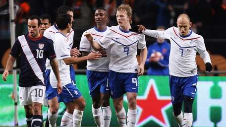 Dirk Kuyt of the Netherlands celebrates his first-half