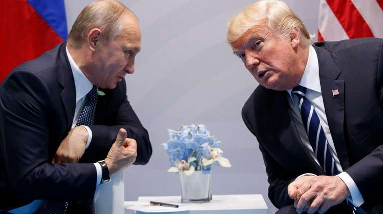 Russian President Vladimir Putin talks with President Donald