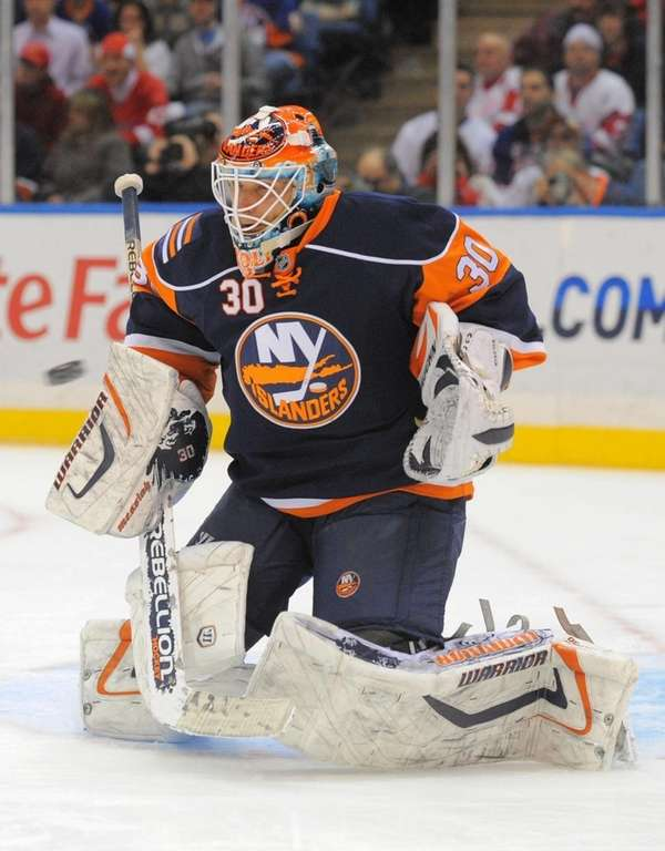 Islanders goalie Dwayne Roloson (30) makes a save