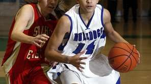 North Babylon's Bria Hartley (14) drives against Sachem's