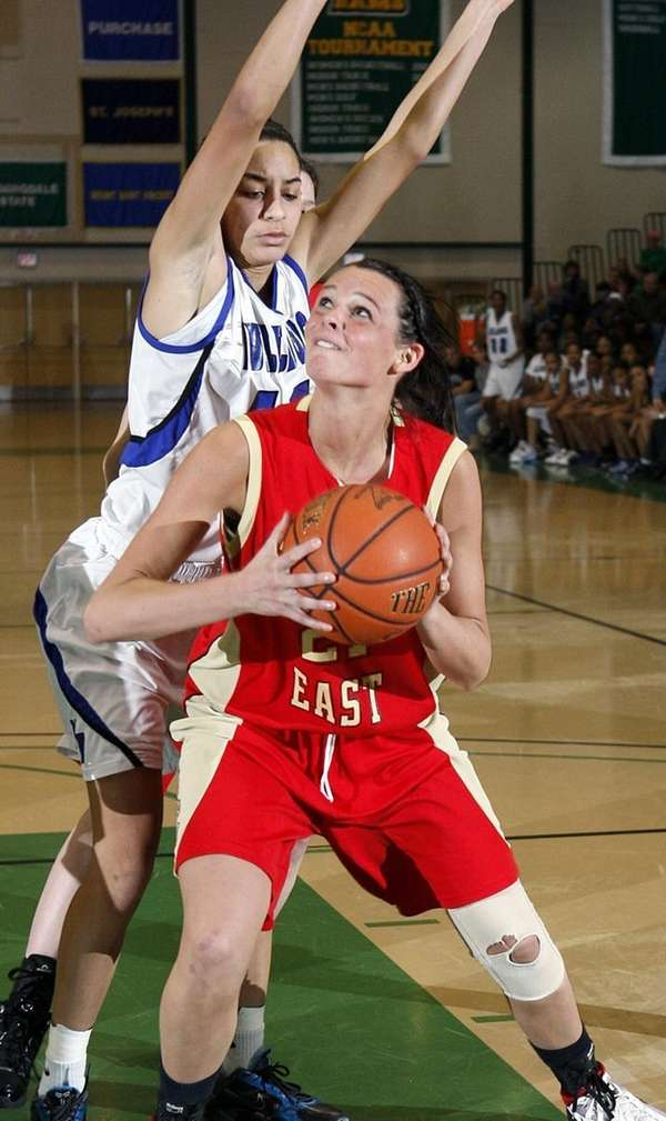 Sachem's Kristen Doherty (21) drives in the paint