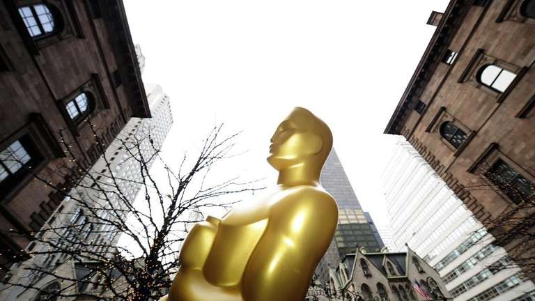 An eight-foot Oscar statue is unloaded in front