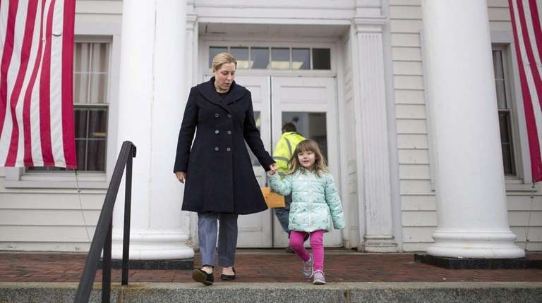 Congressional candidate Liuba Grechen Shirley walks out of
