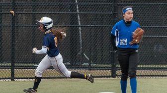 Massapequa's Jenna Defina hits an inside-the-park home run