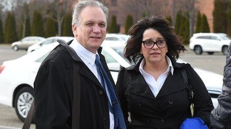 Edward and Linda Mangano leave federal court in