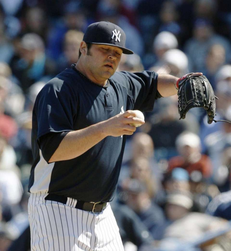 New York Yankees pitcher Joba Chamberlain (62) struggles