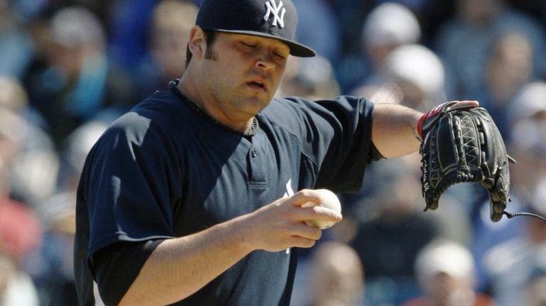 New York Yankees pitcher Joba Chamberlain (62) struggles