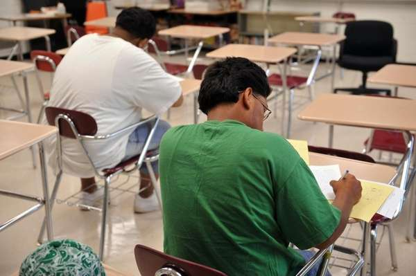 In this file photo, students take an exam