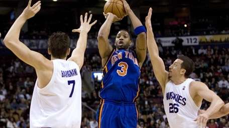 New York Knicks' Tracy McGrady (3) shoots despite