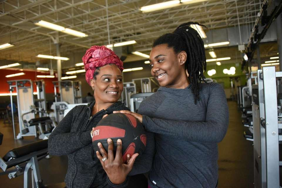 Nicola McLeod and her daughter Jaisen, 15, exercise