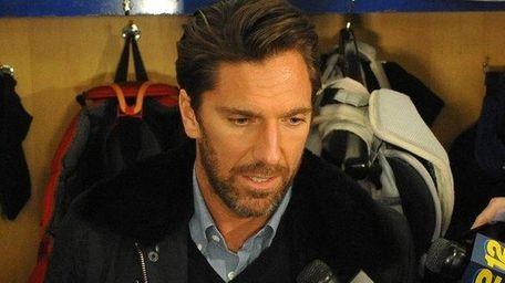 Rangers goalie Henrik Lundqvist speaks with the media