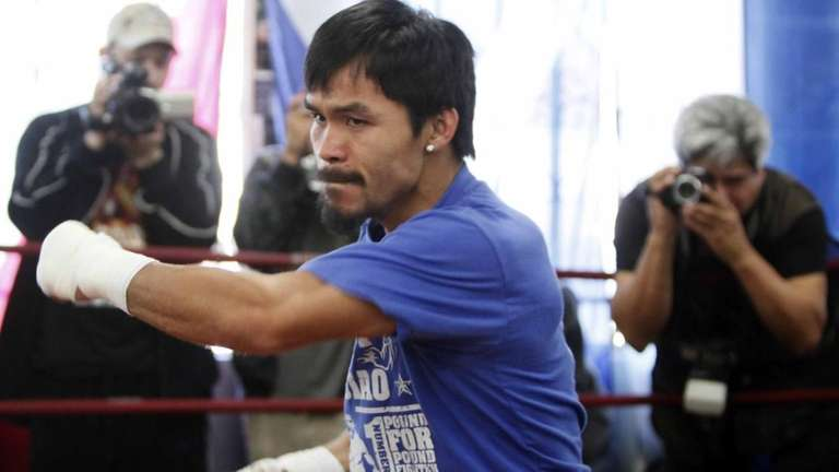 Manny Pacquiao works out with his trainer in