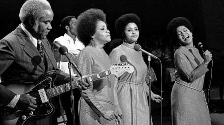The Staple Singers, from left, Pops Staples, Cleotha