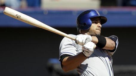 New York Mets' Fernando Martinez hits a solo