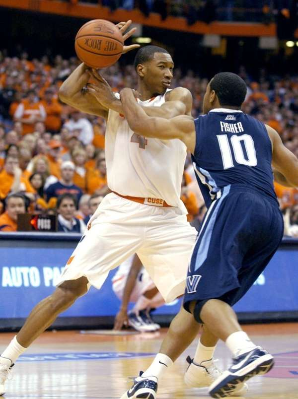 Syracuse's Wesley Johnson has the ball knocked loose
