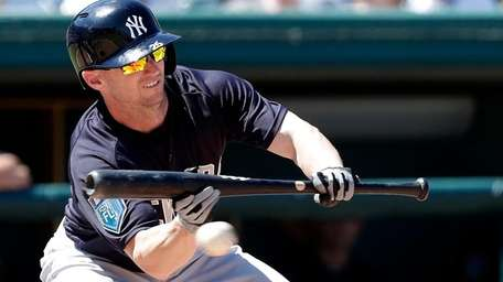 Yankees' Shane Robinson attempts a bunt in the
