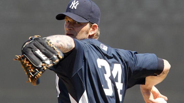 New York Yankees pitcher A.J. Burnett throws against