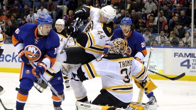 Dennis Seidenberg (44) of the Boston Bruins collides