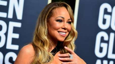 Mariah Carey arrives at the 75th annual Golden
