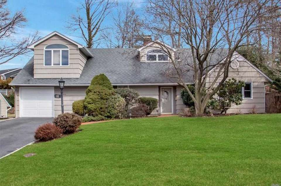 This Roslyn Colonial includes four bedrooms and three