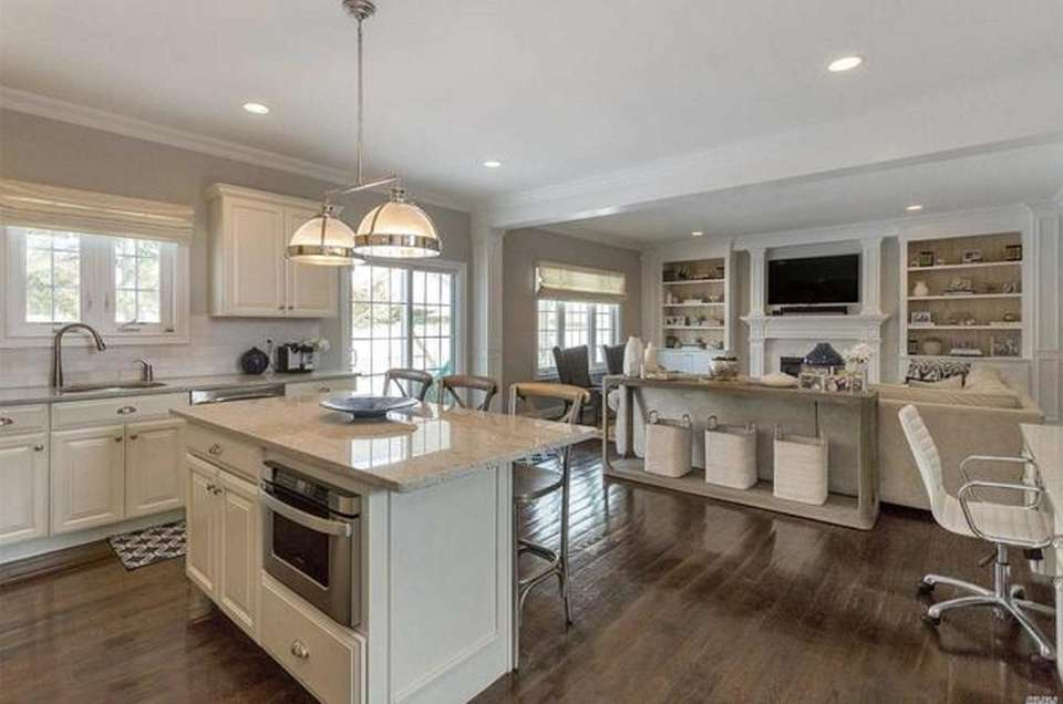 The granite kitchen in this Syosset Colonial opens