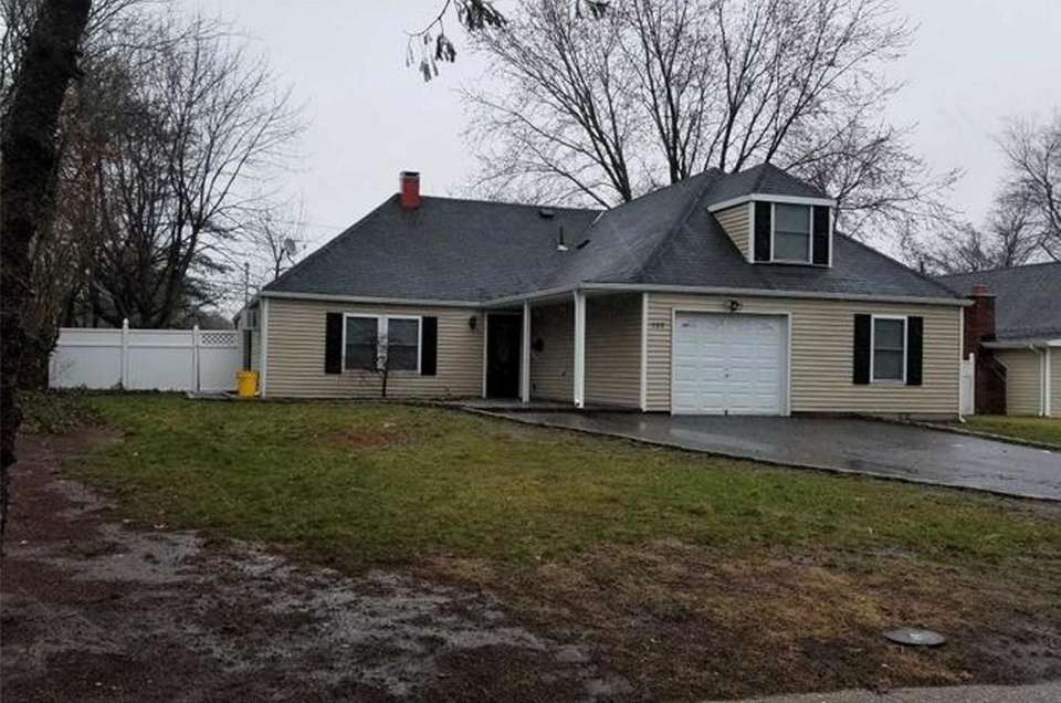 This Islandia farm ranch features five bedrooms and