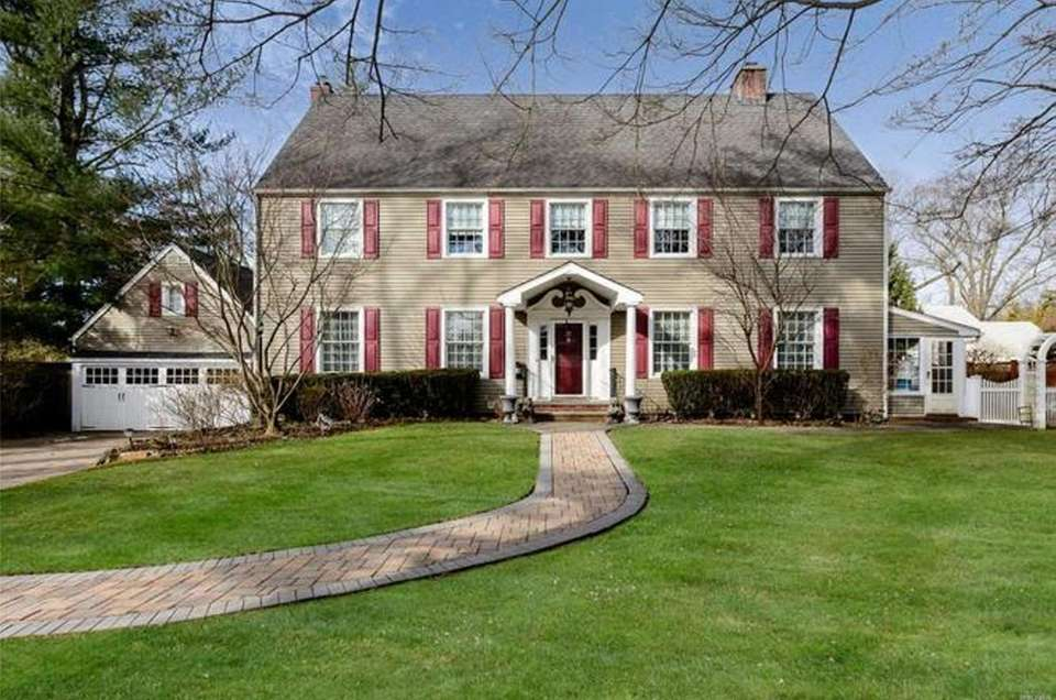 This Westbury Colonial includes four bedrooms and three