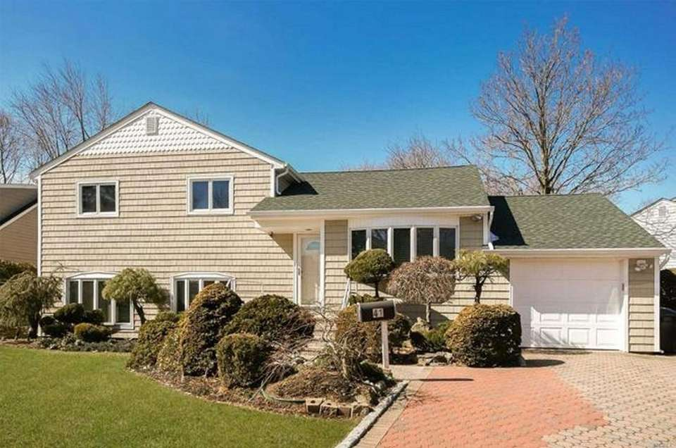 This East Williston split-level includes four bedrooms and