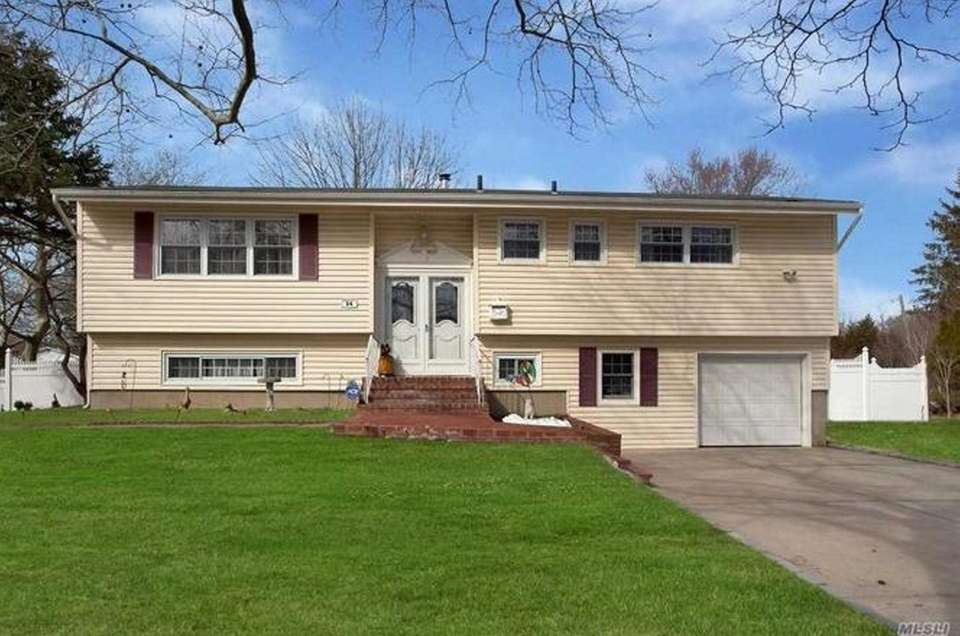 This Dix Hills high-ranch includes five bedrooms and