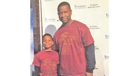 Kidsday reporter Caiden Kitchen and his dad, Roland,