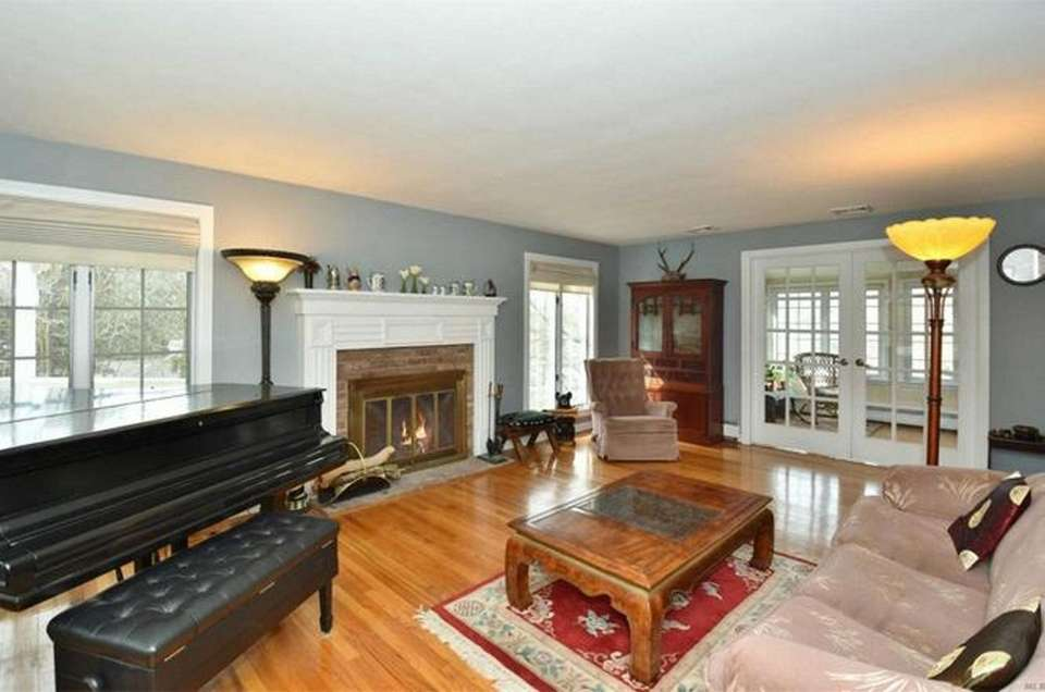The formal living room in this Centerport Colonial