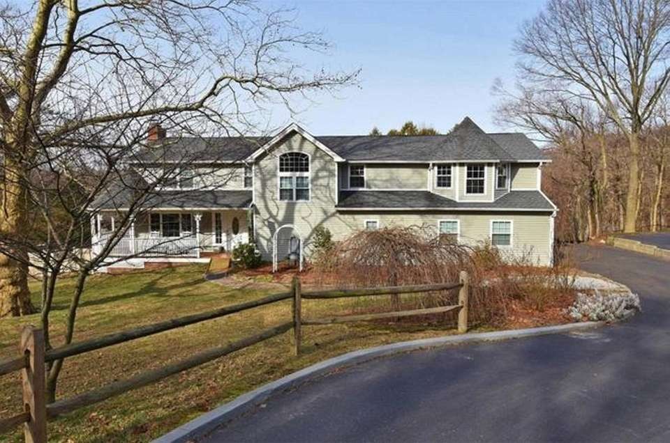This Centerport Colonial includes four bedrooms and four